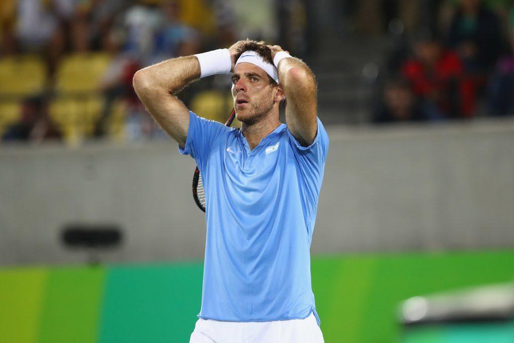 Juan Martin Del Potro of Argentina reacts after defeat.