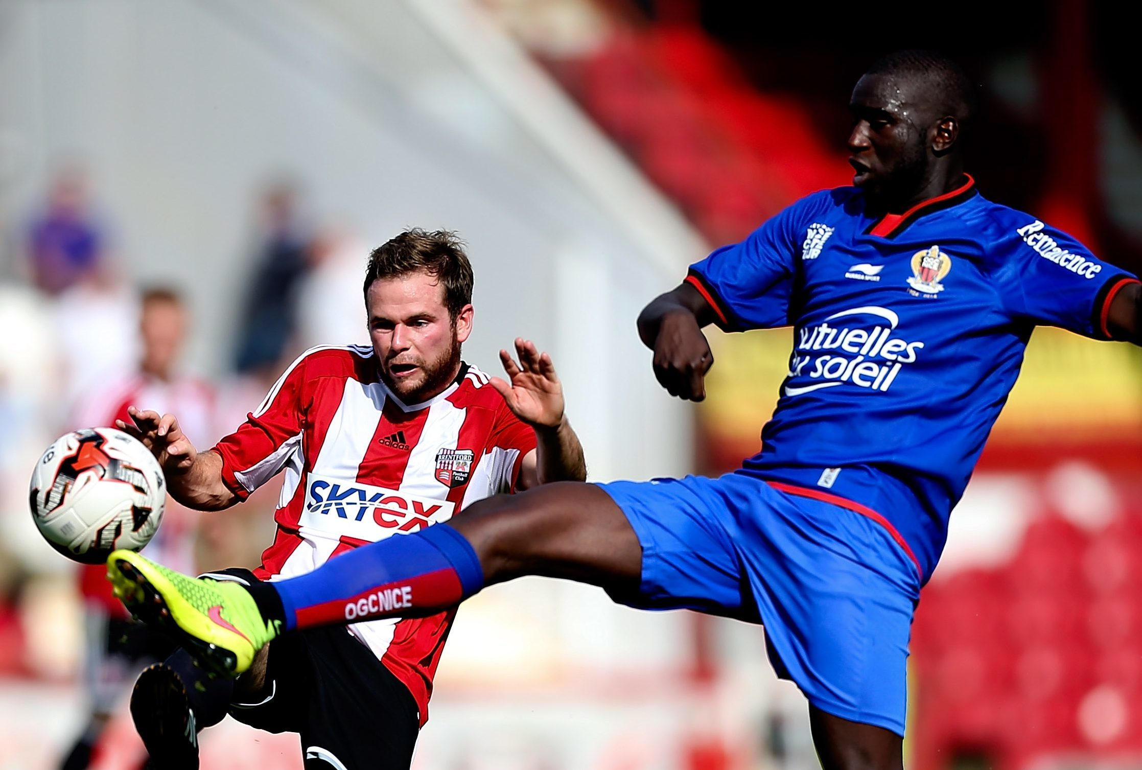 Kevin Gomis in action for Nice against Brentford.