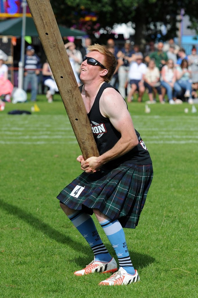 Heavy competitor David Colthart in the caber competition