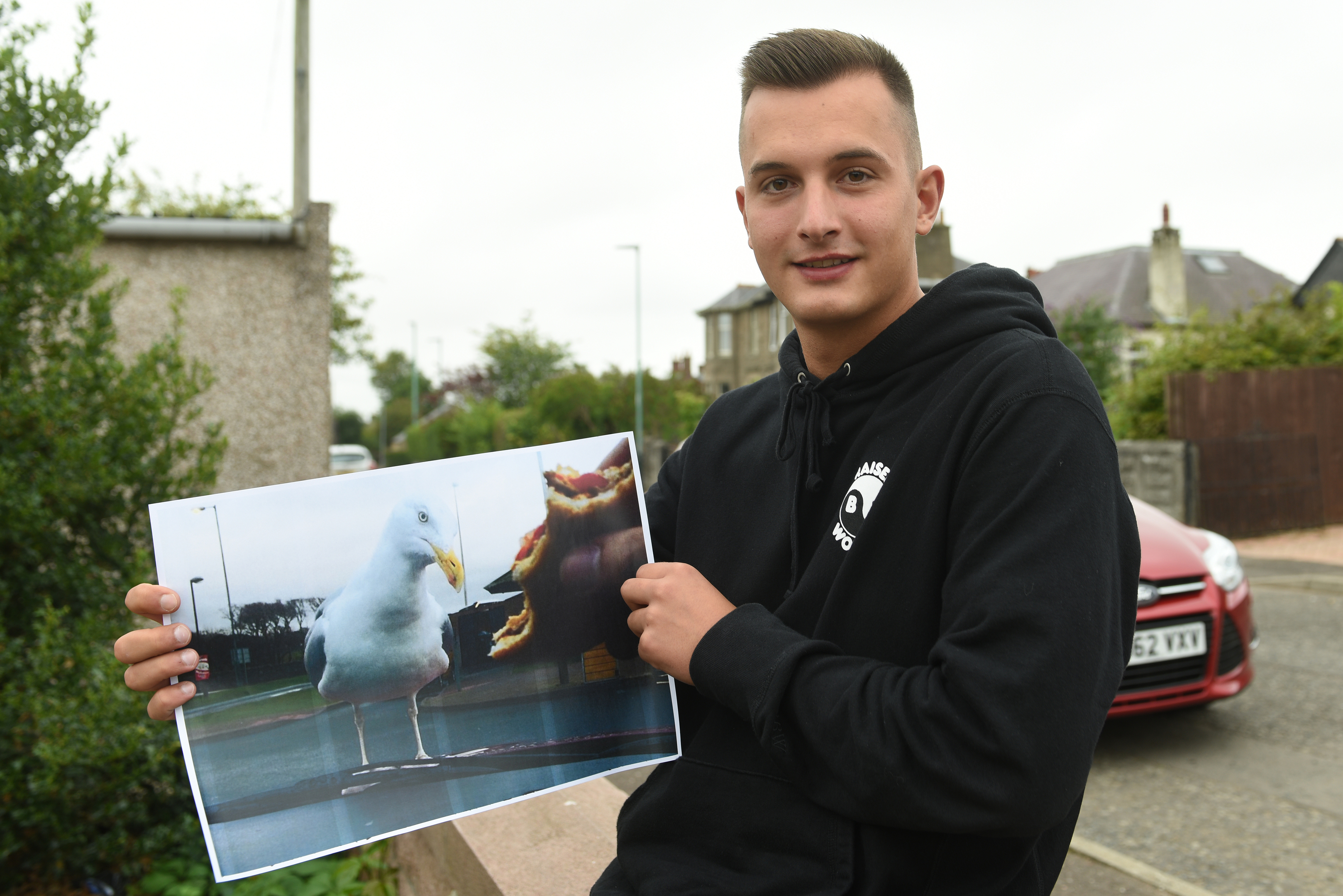 Krystian Mlynarski with a copy of his winning picture.