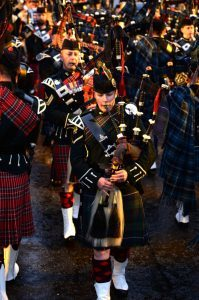 Lance Bombardier Megan Beveridge as the lone piper at the Royal Edinburgh Military Tattoo Photo Caption:- Megan high in the stands at the Royal Edinburgh Military Tattoo. Magic Megan makes musical history at the Royal Edinburgh Military Tattoo! Scottish Soldier, Lance Bombardier Megan Beveridge made piping history when she became the first female to pass the very exacting Army Pipe Major's course. Now she has made history again at the Royal Edinburgh Military Tattoo as the first Regular Army female piper to take on the prestigious role of the Lone Piper at the Scottish capital's annual military music extravaganza. Fifer Megan, who hails from Burntisland, is also the youngest to have attained the Pipe Major's qualification, at the age of 21. She was selected for the honour of being the Lone Piper by the Army's Director of Army Bagpipe Music and Highland Drumming, Major Steven Small, who has carried out the task many times himself as a Piper for The Black Watch – now known as The 3rd Battalion The Royal Regiment of Scotland. She was the sole focus of the 8,800-strong audience, as she was lit up on the Castle Ramparts, after the massed Pipes and Drums and Military Bands on the Esplanade fell silent and she played the famous lament 'Sleep Dearie Sleep' at the end of the finale. This is cited by many Tattoo-goers as the most moving and uplifting part of the show and is certainly one of the greatest honours and achievements that any Army Piper can hope to achieve. Almost all professional Pipers and Drummers in the Regular Army are from Infantry or Royal Armoured Corps units. Megan is a member of 19th Regiment Royal Artillery, The Scottish Gunners, who are unusual in the fact that they are not an Infantry or a Royal Armoured Corps Regiment, but still have a Pipes and Drums on their strength. Women can serve in Artillery Regiments in the Army, so Megan chose The Scottish Gunners as her Regiment to further improve her prospects as a Piper. When she isn't pipin