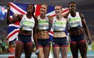 Great Britain's Christine Ohuruogu, Eilidh Doyle, Anyika Onuora and Emily Diamond celebrate bronze following the women's 4x400m relay final at the Olympic Stadium on the fifteenth day of the Rio Olympics