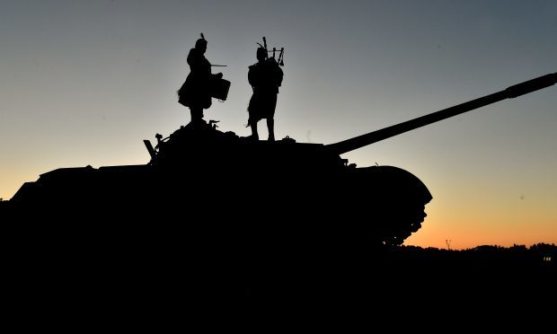 7 SCOTS piper Pte Keith Christie and drummer Lcpl David Hay on top of a former Soviet-built T72 tank at Red Earth military base in Croatia