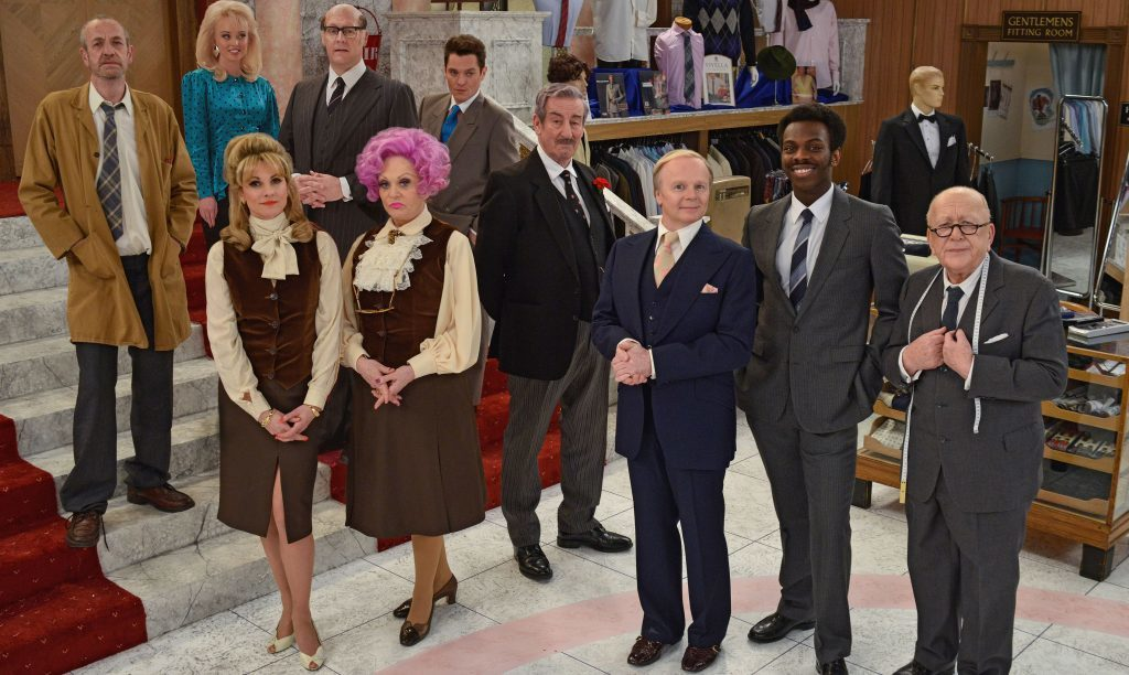 The new cast of Are you Being Served? (back left-right) Arthur Smith as Mr Harman, Jorgie Porter as Miss Croft,Justin Edwards as Mr Rumbold and Matthew Horne as Mr Grace, (front left-right) Niky Wardley as Miss Brahms, Sherrie Hewson as Mrs Slocombe, John Challis as Captain Peacock, Jason Watkins as Mr Humphries, Kayode Ewumi as Mr Conway and Roy Barraclough as Mr Grainger.