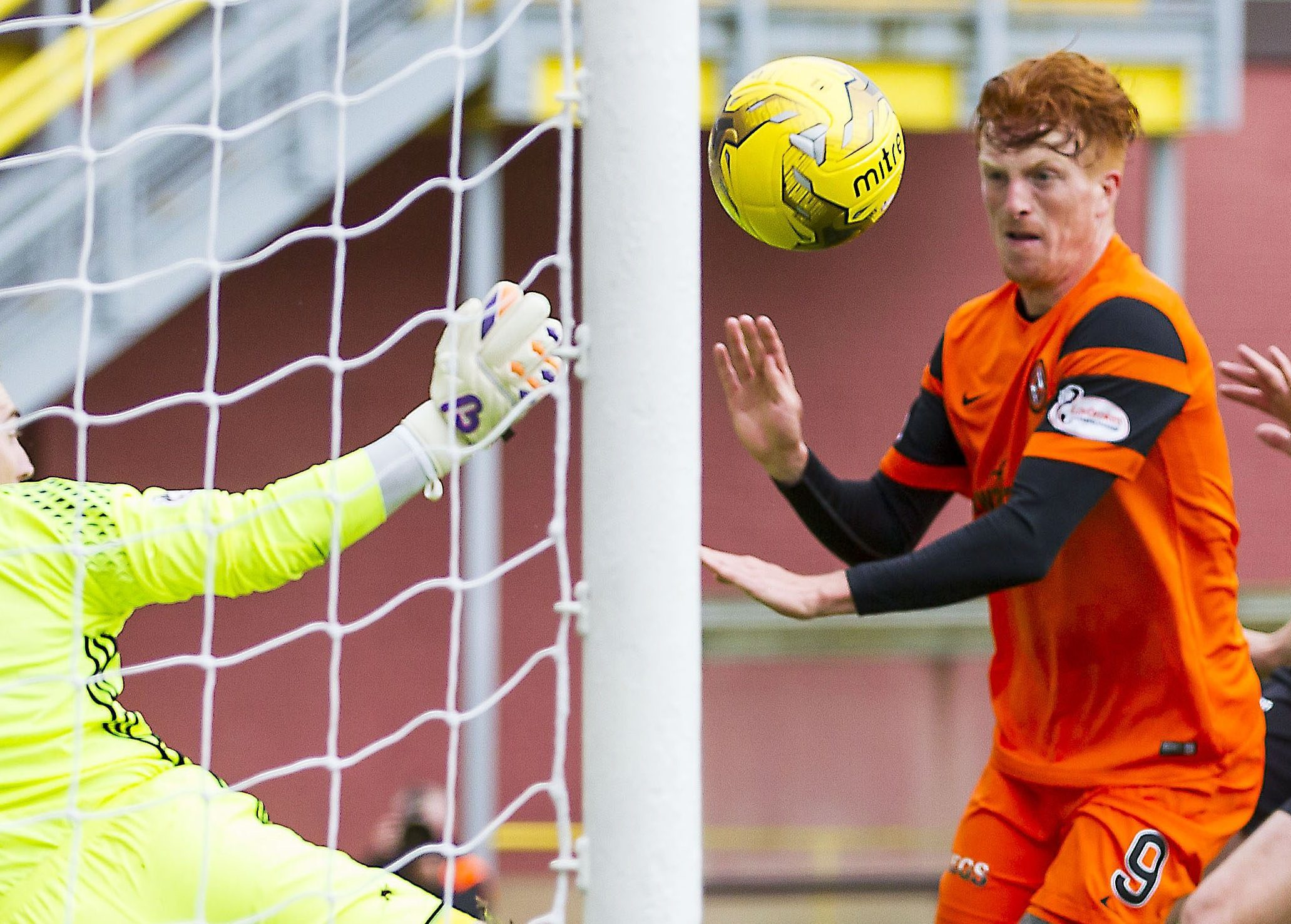 Simon Murray prepares to net the first goal for United.
