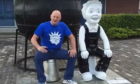Gary Robertson pulls up a bucket beside the 'Oor Original' statue at City Quay to put the world to rights.