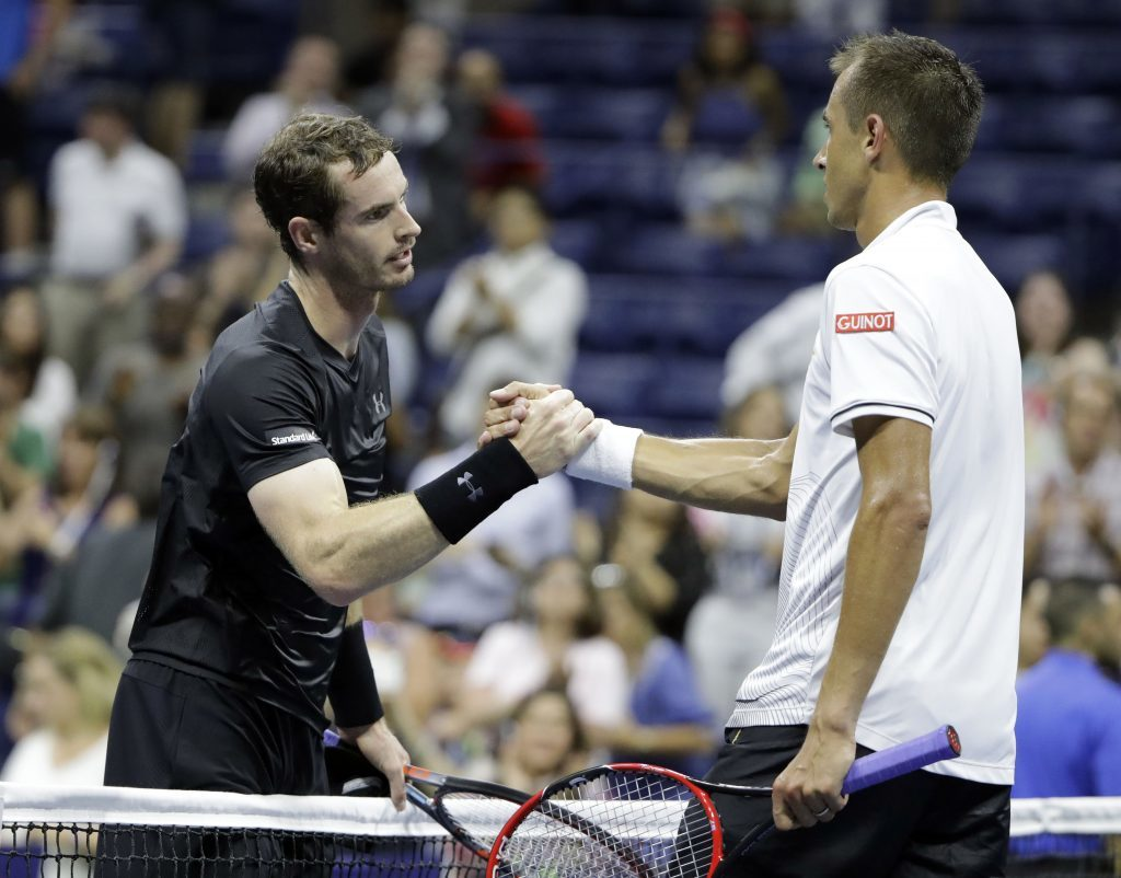 Andy Murray is congratulated by Lukas Rosol.