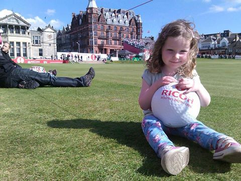 A youngster savours the atmosphere at the British Women's Open in St Andrews in 2013