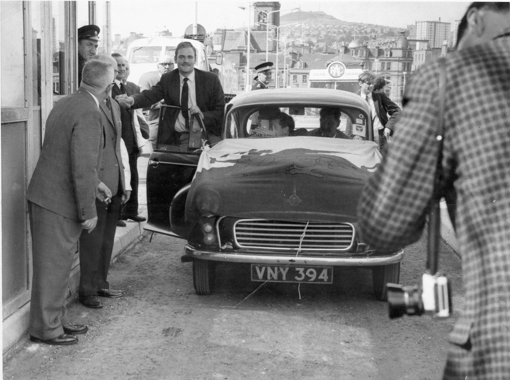 Hugh Pincott making history as the first member of the public to drive across the Tay Road Bridge when it officially opened on August 18, 1966