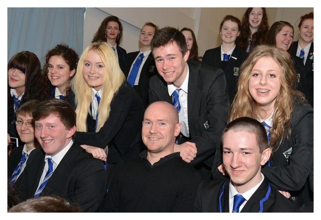 Black Watch writer Gregory Burke chatting to pupils at Beath High School, Cowdenbeath.