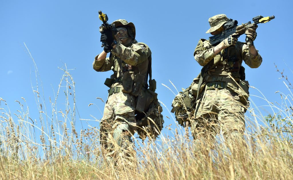 1 Platoon, 1 Section, Pte James Gilbert of Aberdeen (left) and Pte Will Capon of Aberdeen, in a training operation in a built up area.