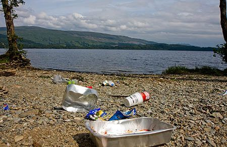 Litter on the shore of Loch Lomond where wild camping is being managed in some areas.