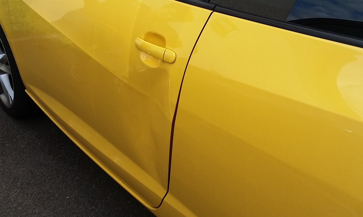 The dent left in the family's car.