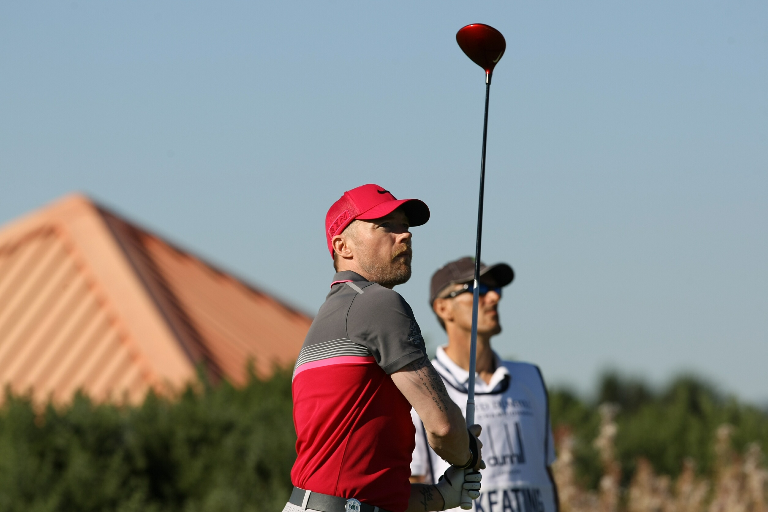 Ronan Keating watches his drive off the 14th tee at Carnoustie last year