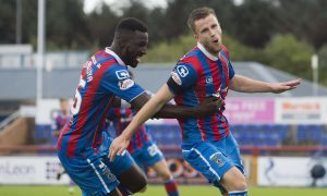 Inverness's Liam Polworth celebrates with team-mate Lonsana Doumbouya.