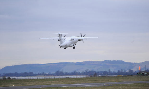 A plane leaves Dundee Airport.