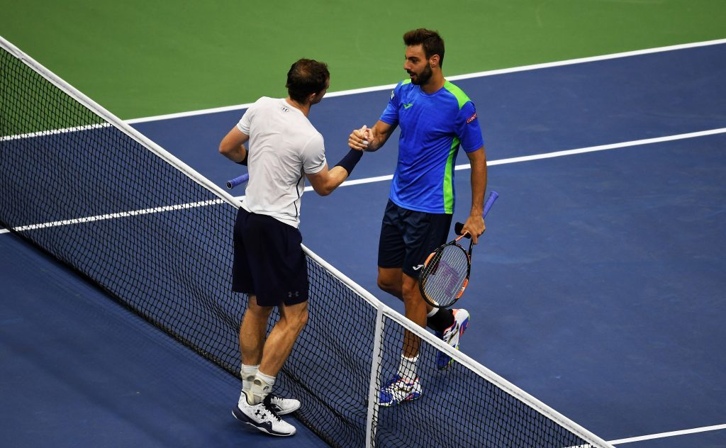 Andy Murray shakes hands with Marcel Granollers.
