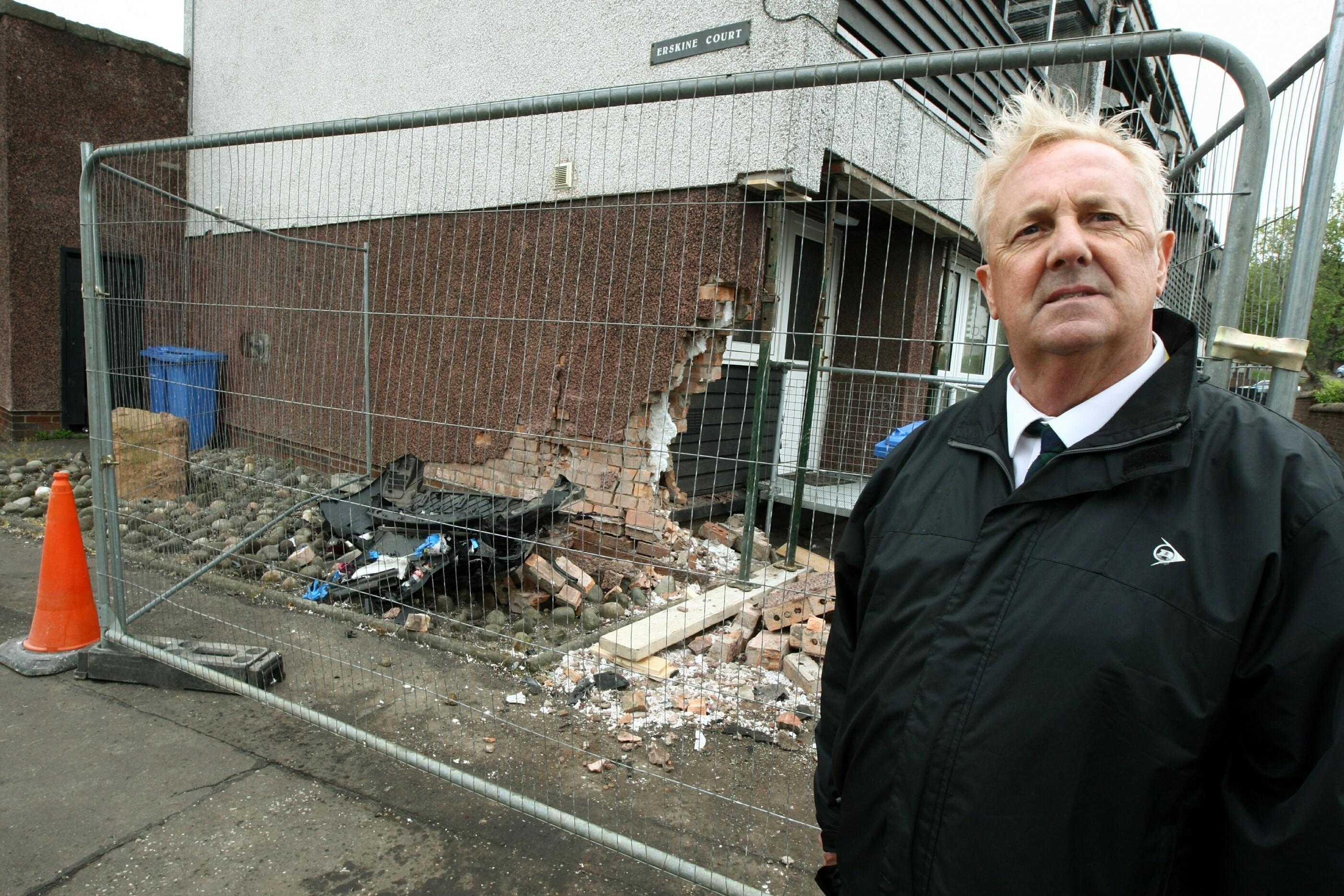 Councillor John O'Brien at the damaged flat