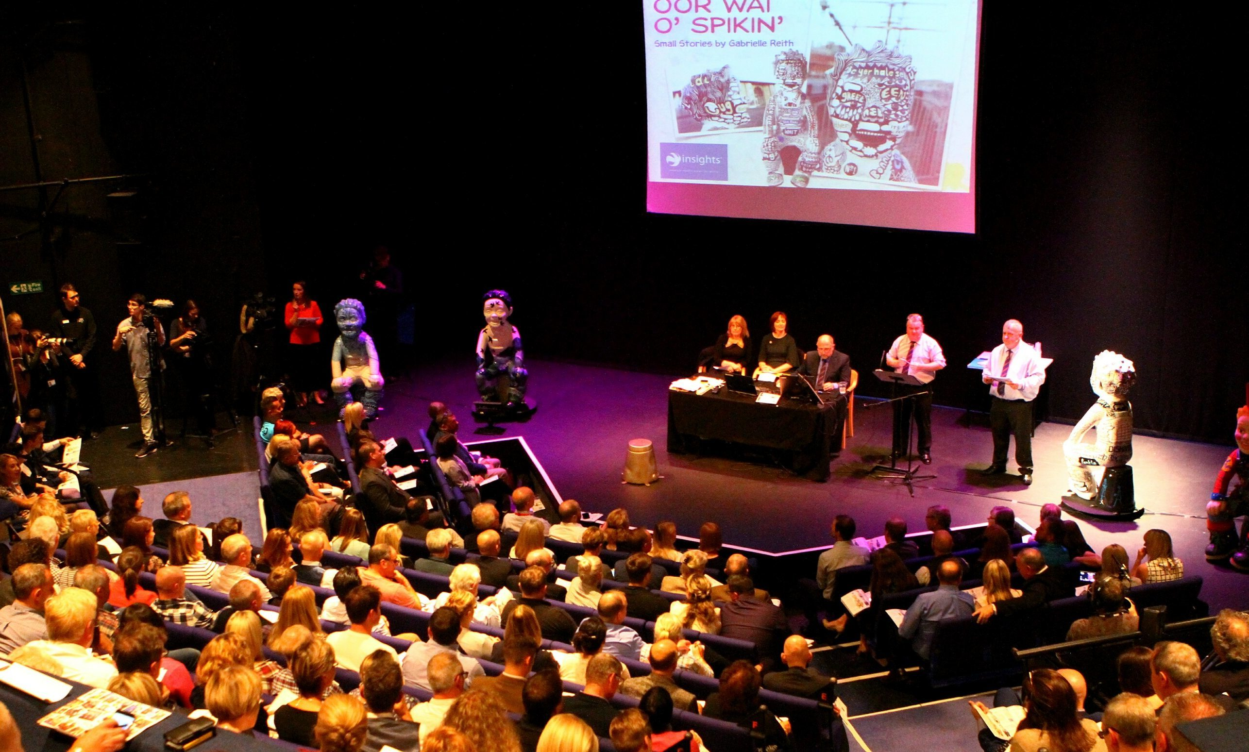 The auction under way in front of a capacity audience at Dundee Rep.