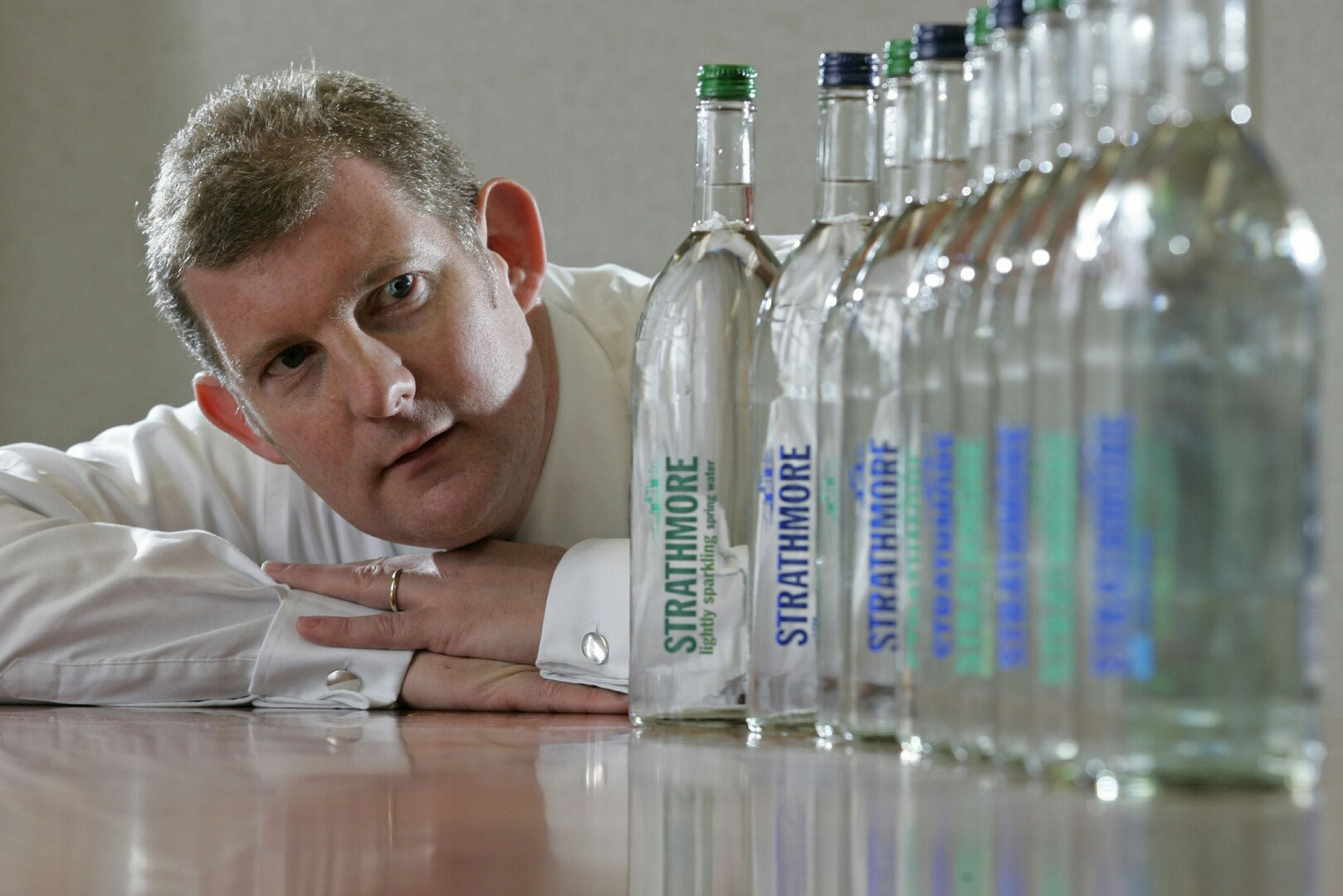 AG Barr CEO Roger White with a range of Strathmore water products