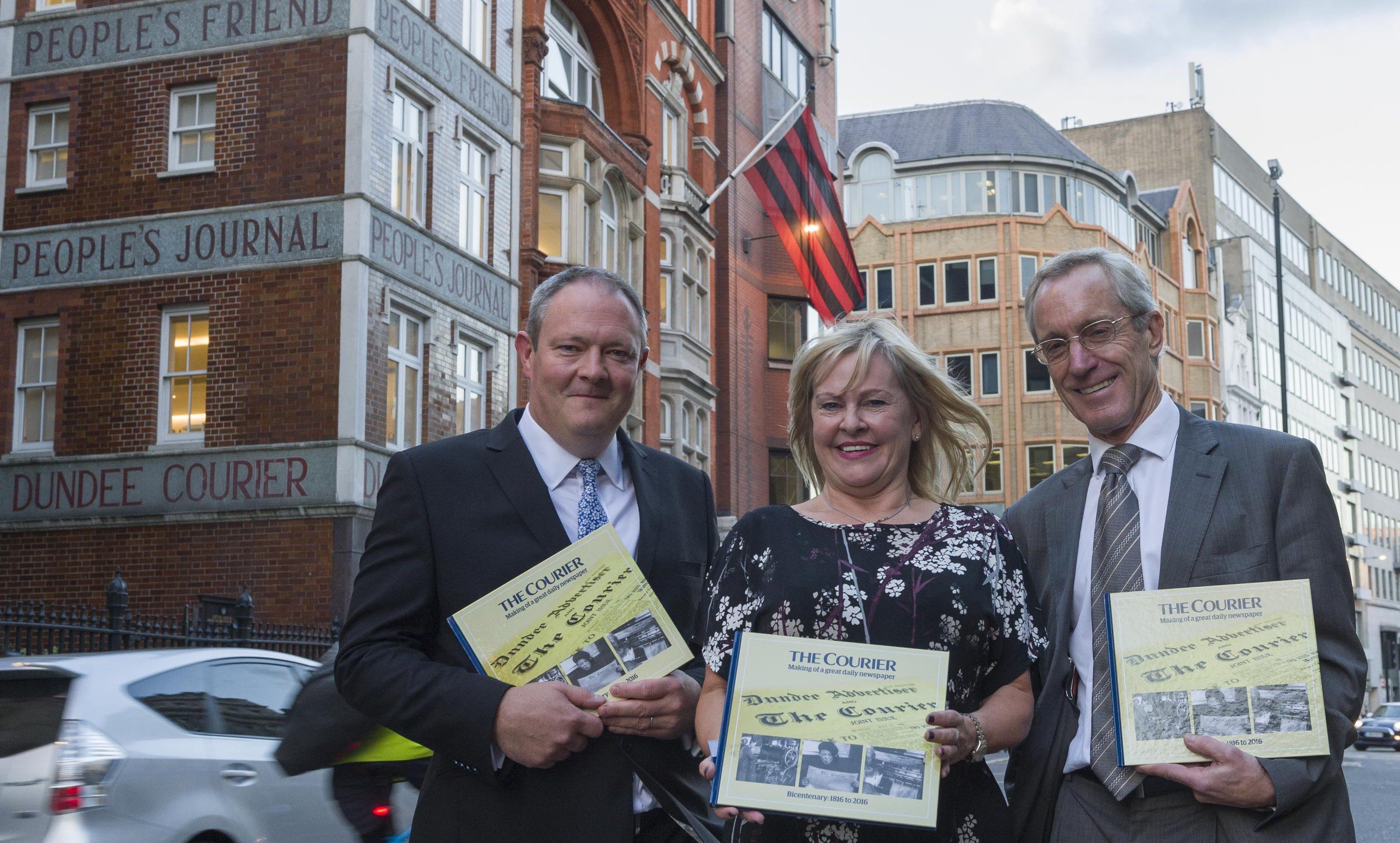 Richard Neville, Denise West, and Richard Hall outside DC Thomson's offices in Fleet Street.