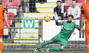 Cammy Bell makes one of his three penalty saves at Dunfermline.