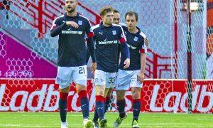 Dundee celebrate Paul McGowan's shot finding the net.