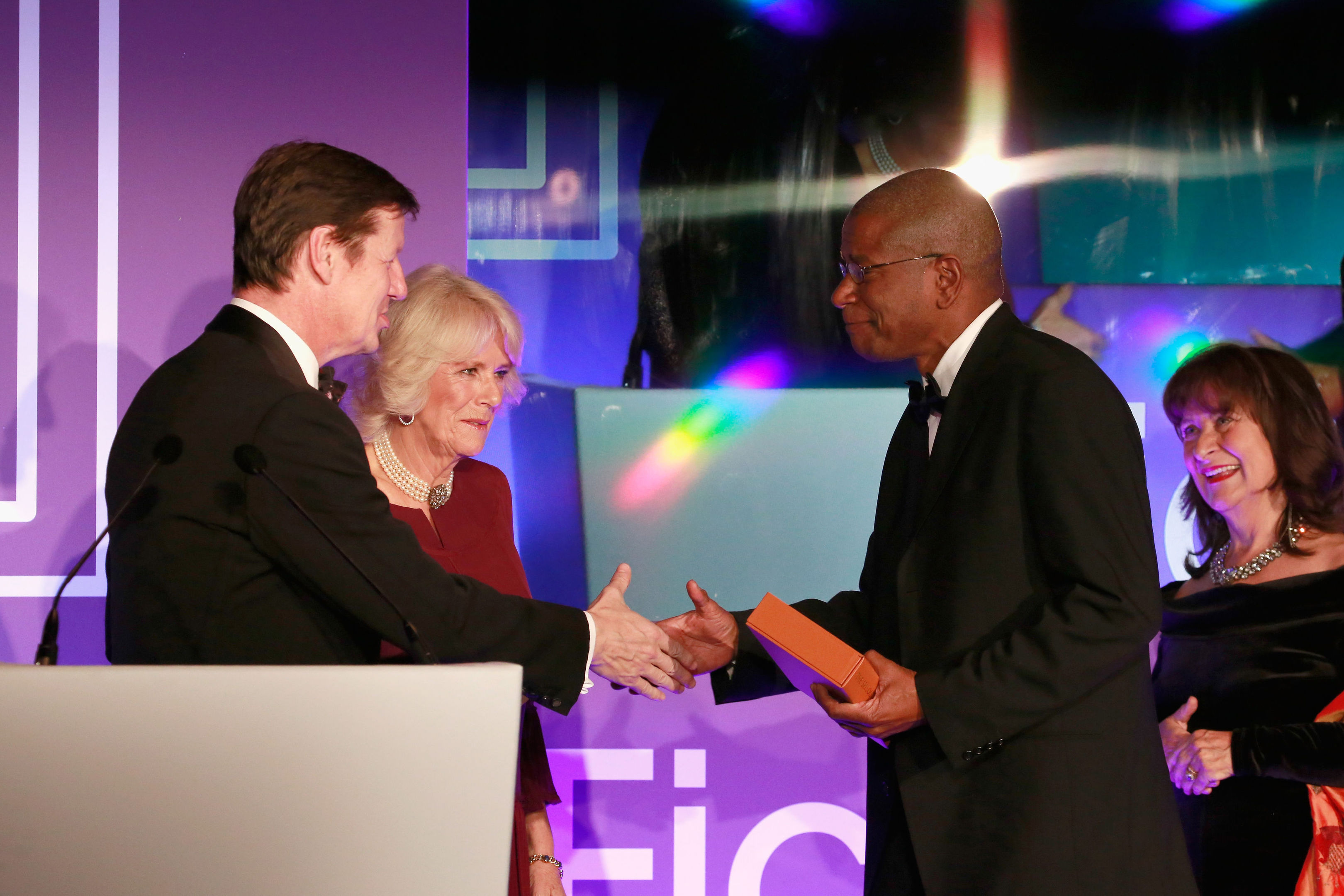 The Duchess of Cornwall presents Paul Beatty with a bound copy of his book.