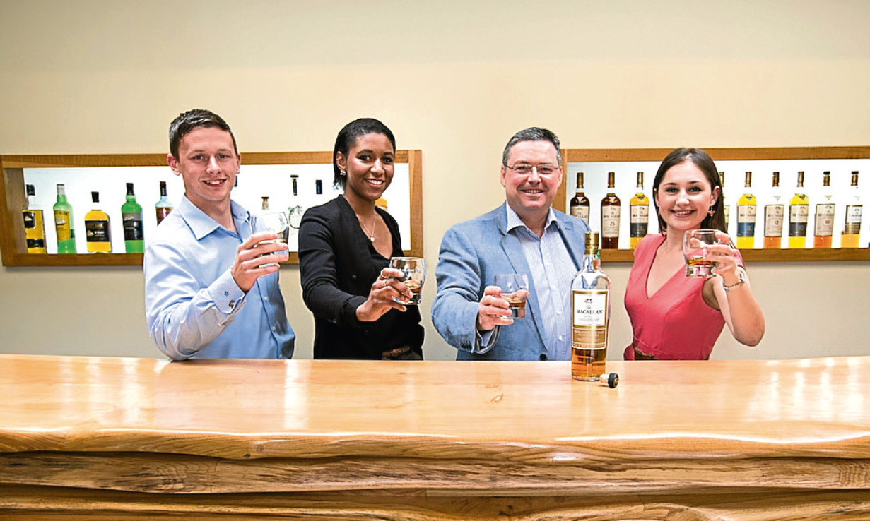 Saltire scholars Scott Barrie, Nadia Fraser and Alice Leyshon raise a dram with The Macallan managing director Scott McCroskie