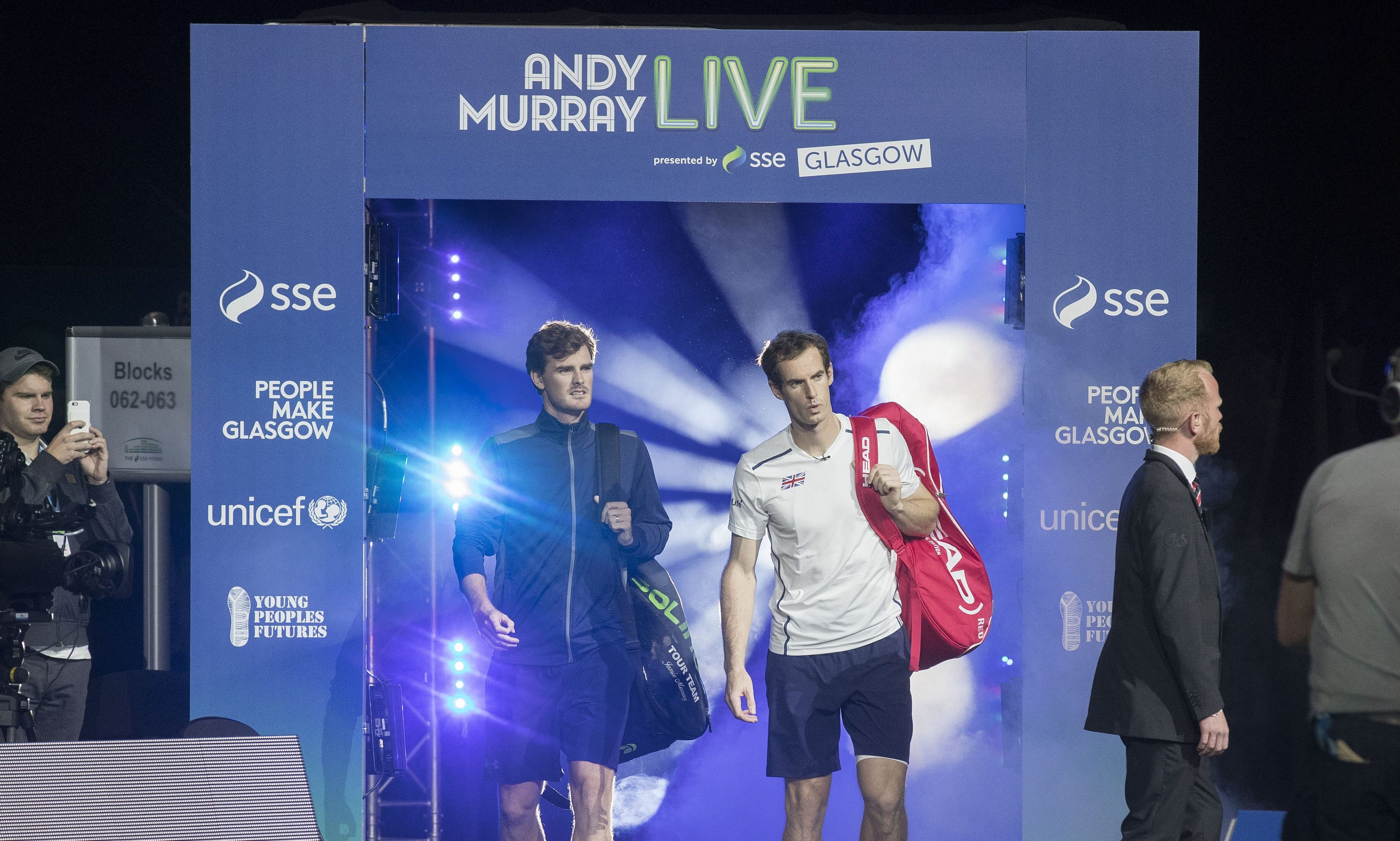 Jamie Murray and Andy Murray walk on to court during Andy Murray Live in September.