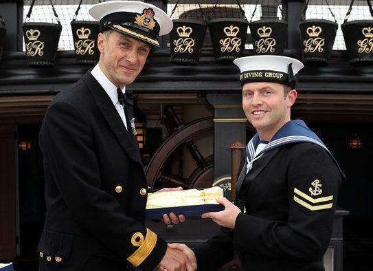 Scott McAllister (right) receives his award