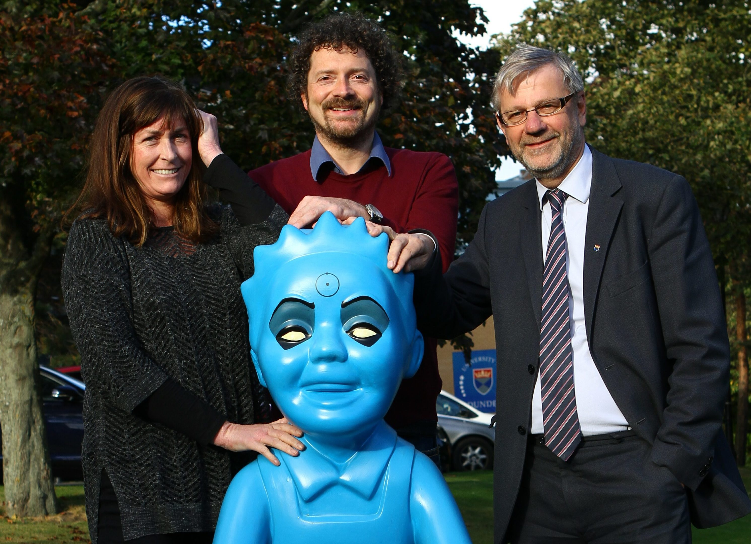 Chris van der Kuyl and wife Heather pose with Dr Manhattan Wullie and Prof Sir Pete Downes