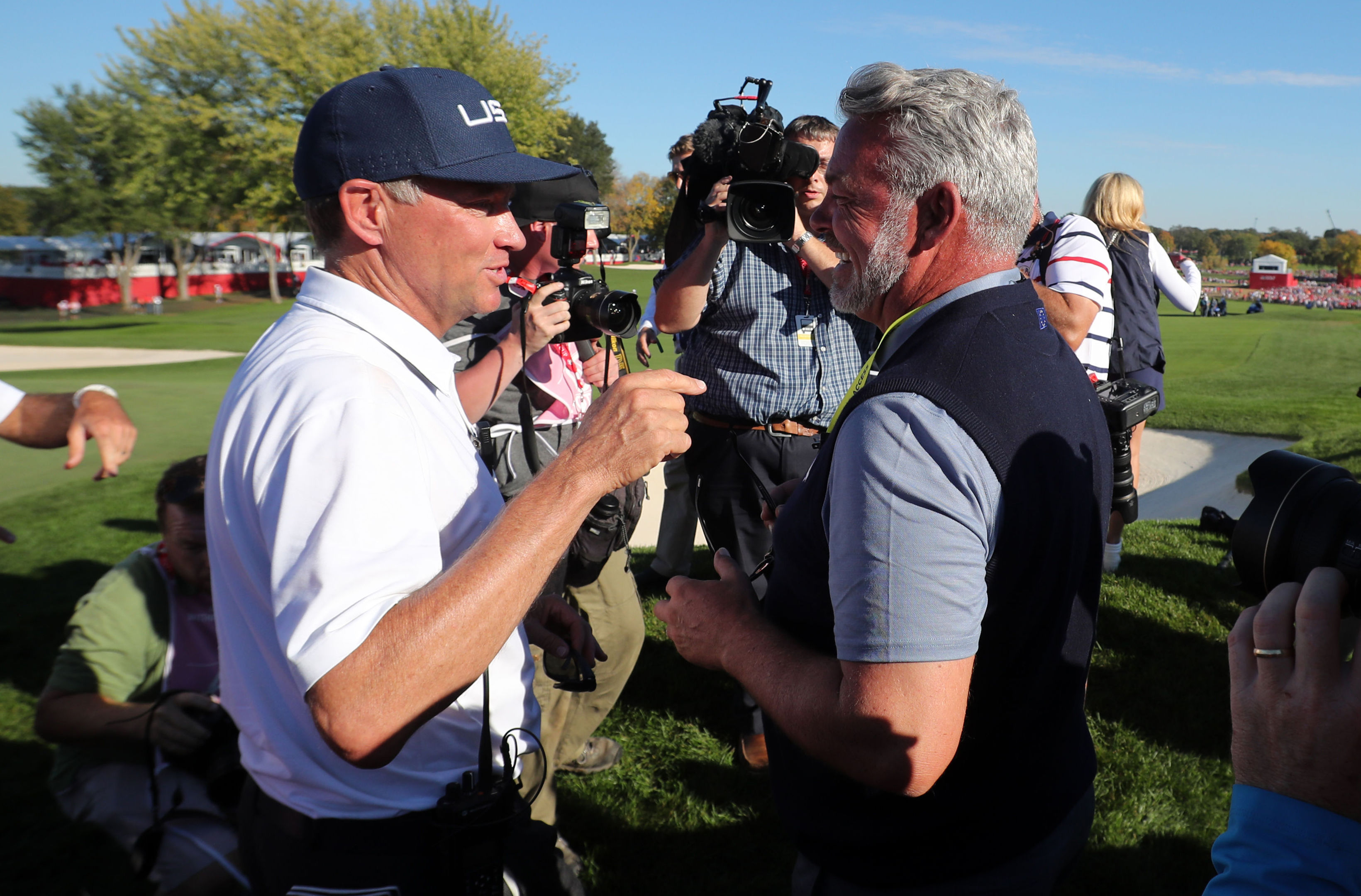 Darren Clarke congratulates David Love III on the US Ryder Cup victory at Hazeltine.