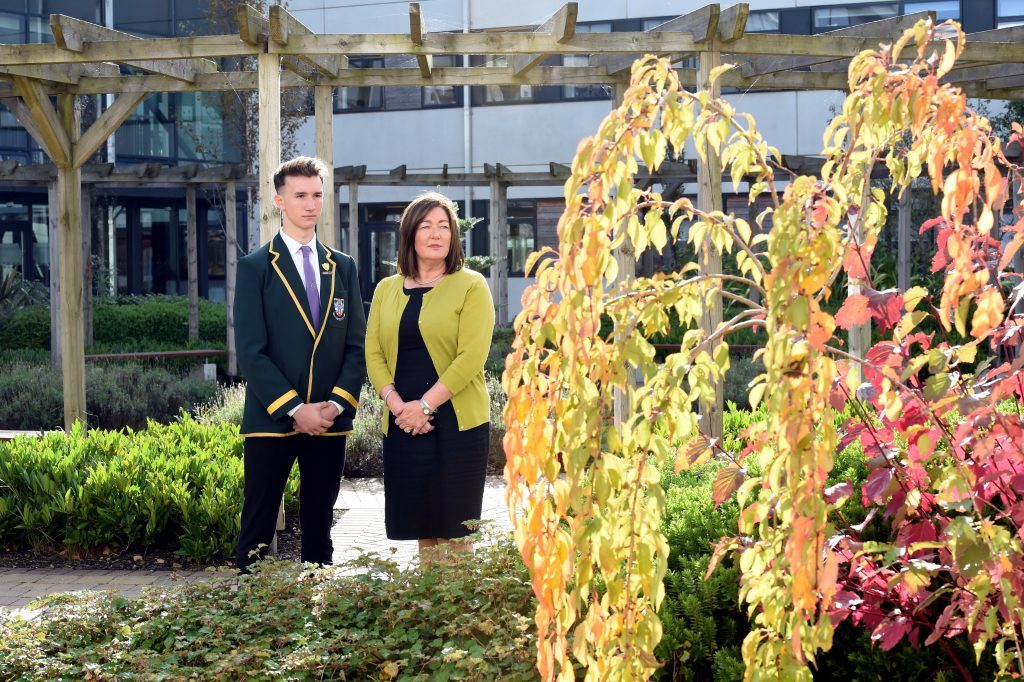 Cults Academy Head Teacher, Anna Muirhead and Head Boy, Luke Morrice, at the Bailey Gwynne memorial tree in the courtyard of the school.