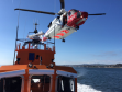 The Broughty Ferry lifeboat and a rescue helicopter from