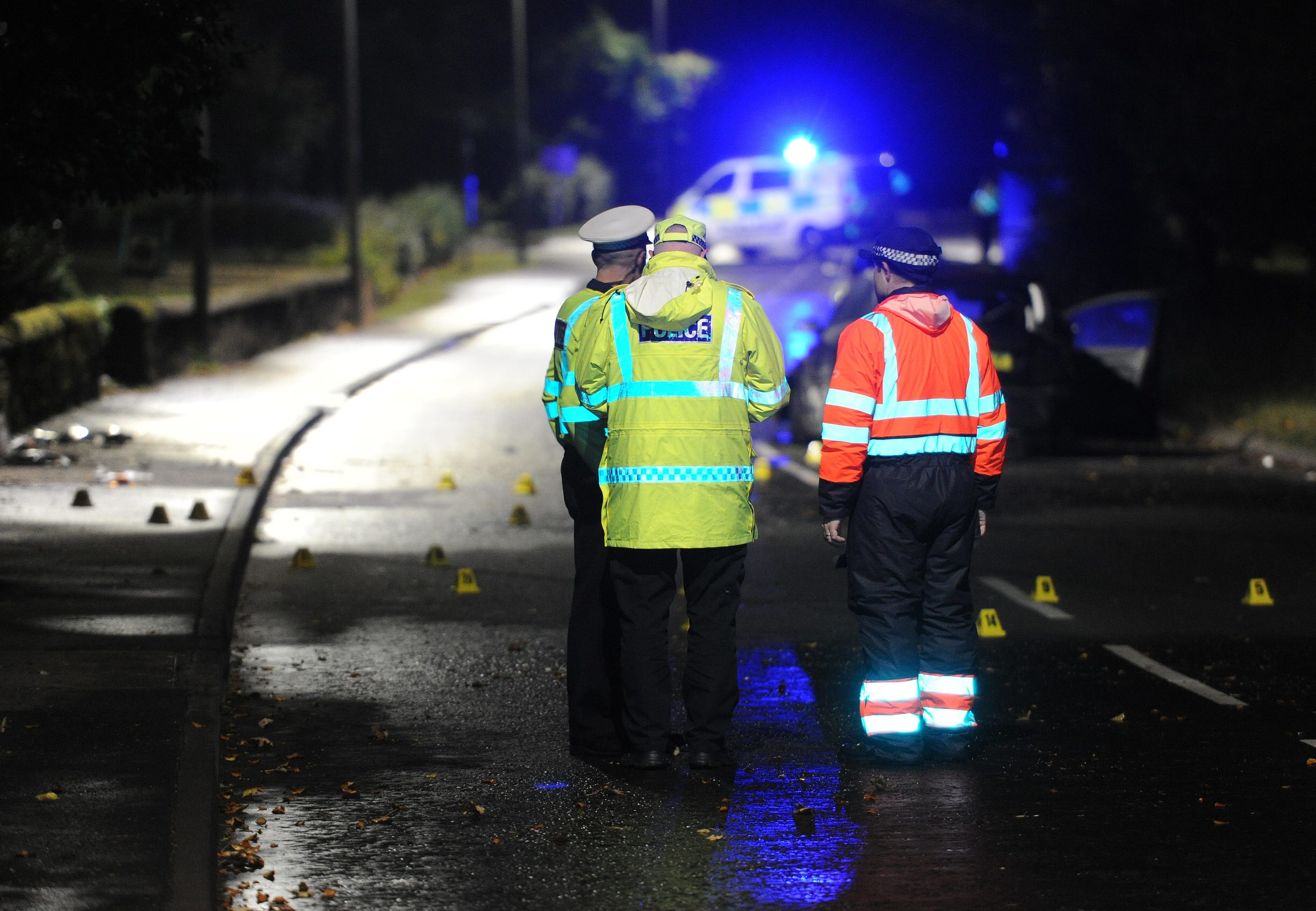 Police accident investigators at the scene of the tragedy.