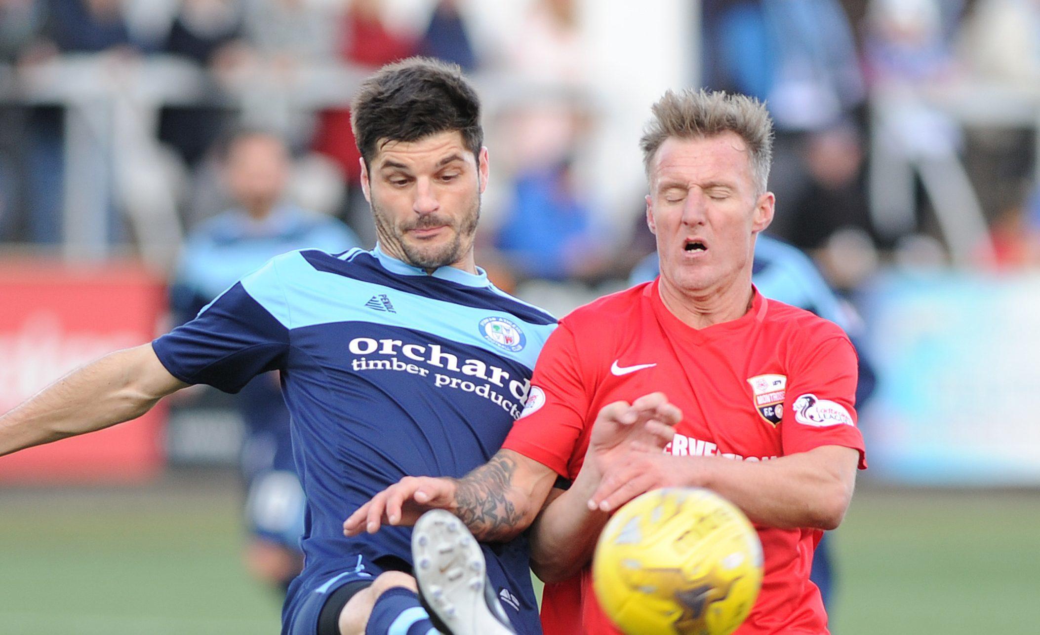 Stuart Malcolm, left, in action against Montrose last week.