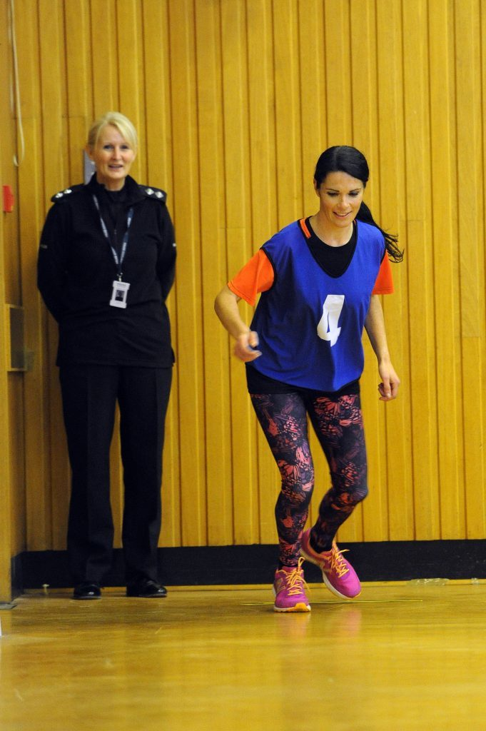 Inspector Irene Coyle watches Gayle in action.