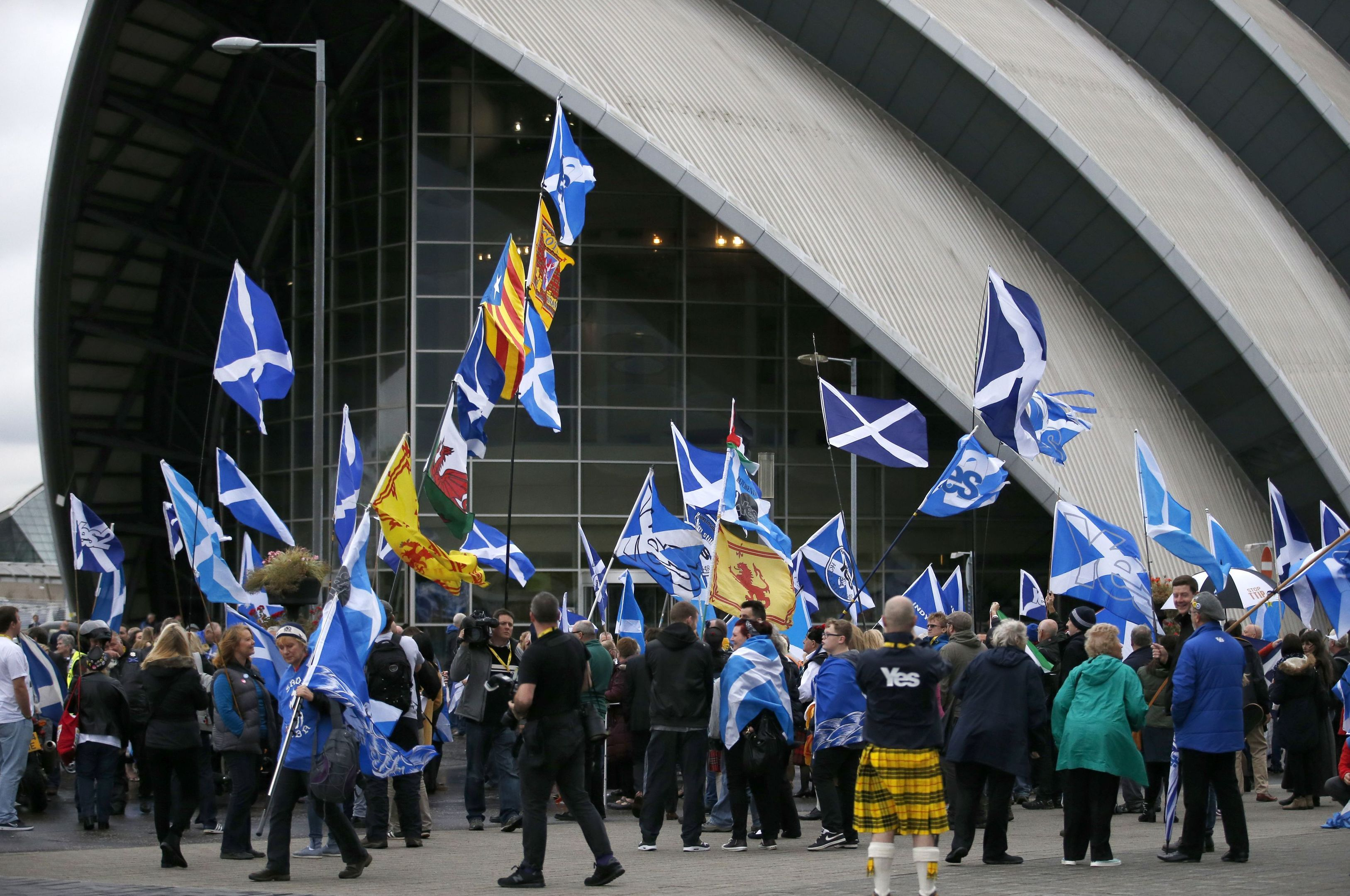 Scottish Independence activists take part in an Independence 2 rally, outside  the SNP conference in Glasgow.