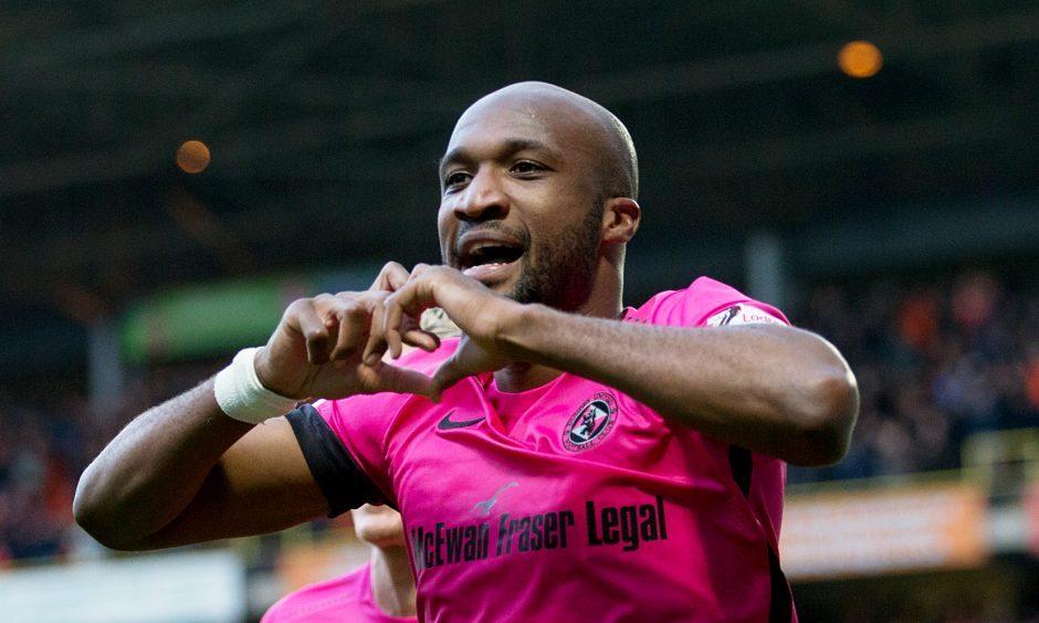 William Edjenguele celebrates his goal.