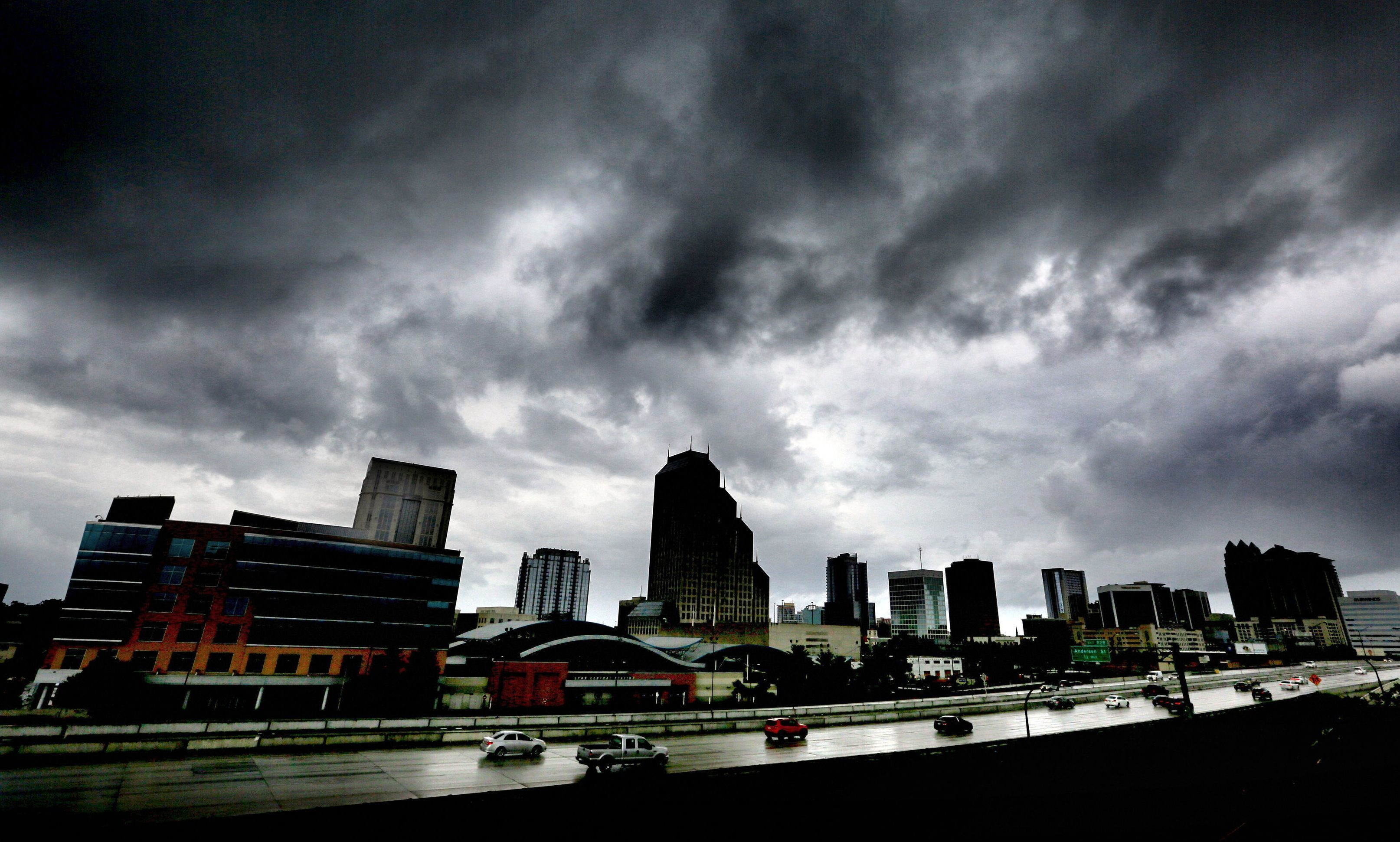 The first outer bands of rain from Hurricane Matthew pass over downtown Orlando on Thursday evening.