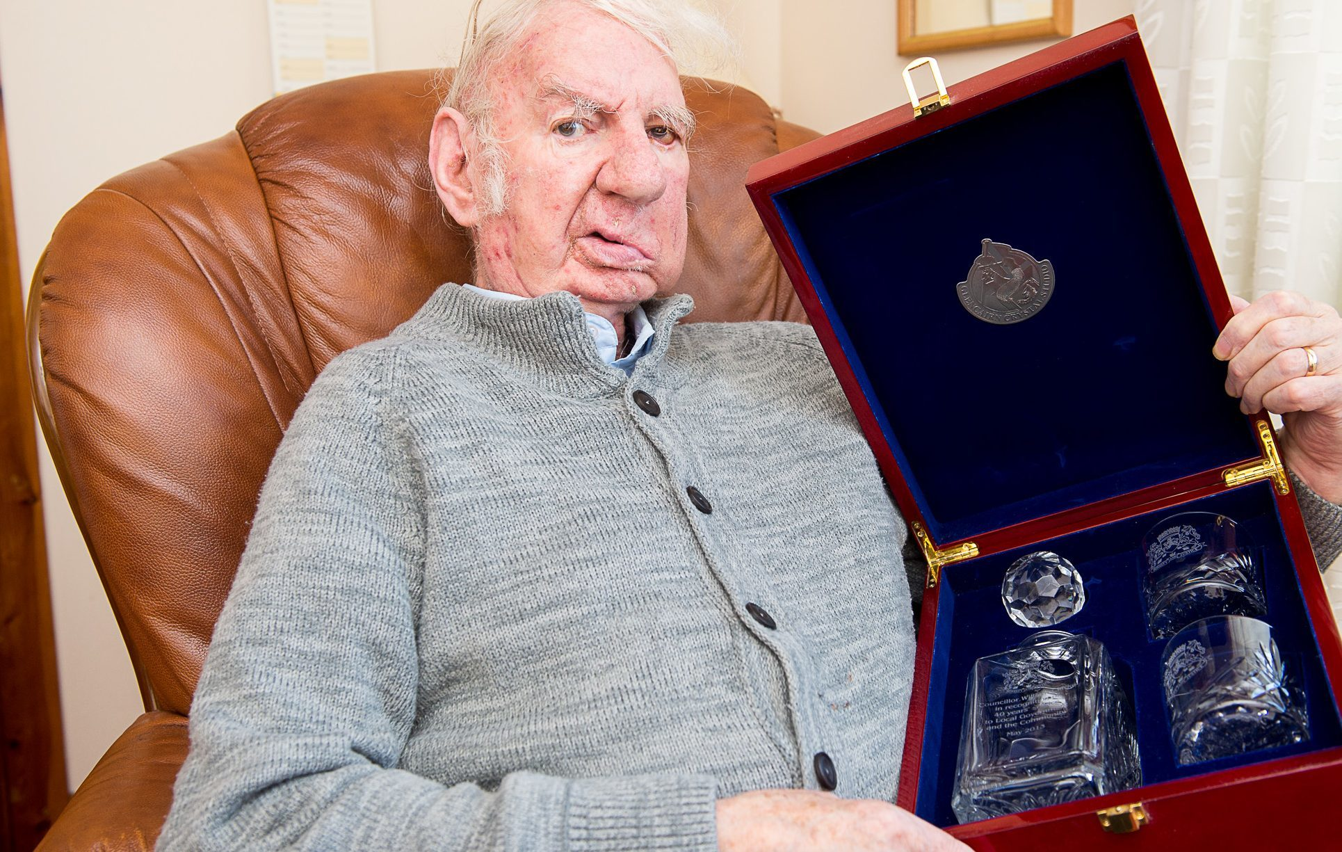 Willie Clarke with a gift from Fife Council when he stood down as councillor