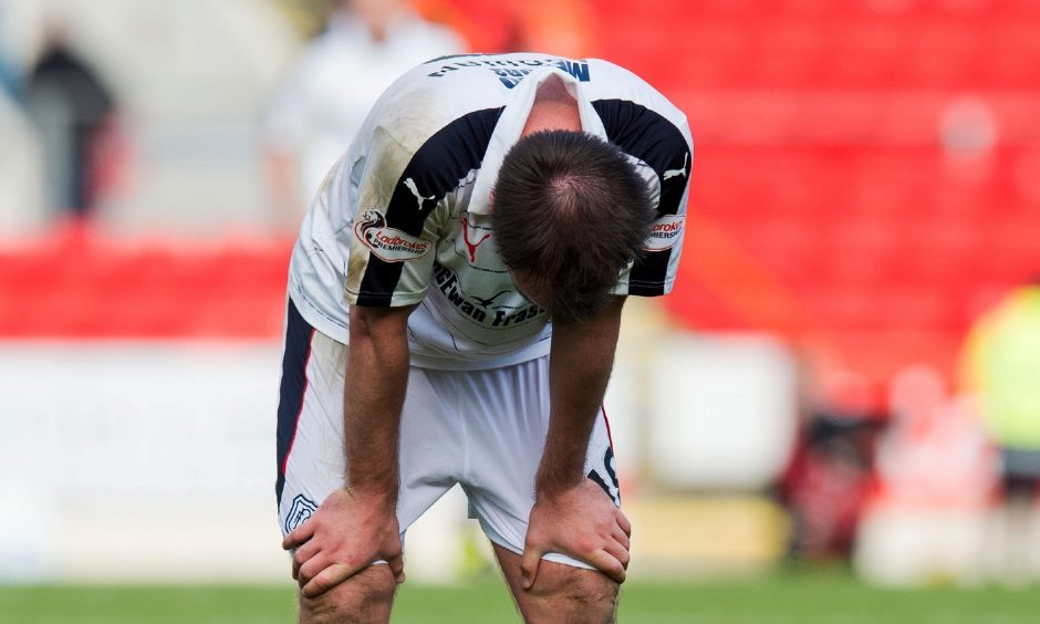 23/10/16 LADBROKES PREMIERSHIP    ST JOHNSTONE V DUNDEE    MCDIARMID PARK - PERTH    Dundeea??s PAul McGowan dejection at full time