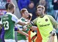 Dundee United's Cammy Bell shakes hands with Hibs' Ofir Marciano the last time the teams played.