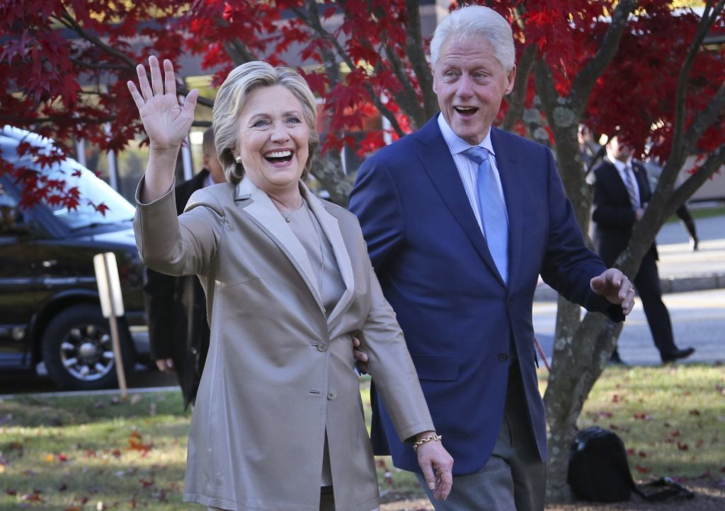 Democratic presidential candidate Hillary Clinton, and her husband former President Bill Clinton, greet supporters after voting in Chappaqua, N.Y.
