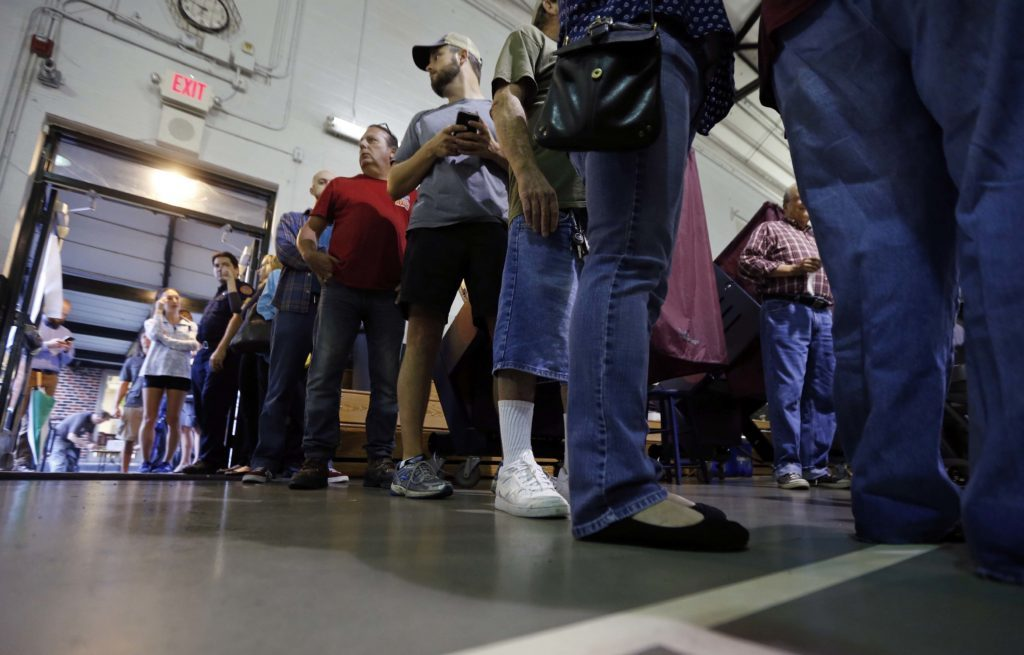People stand in line to vote at St. Dominic's School on Election Day in the Lakeview section of New Orleans,