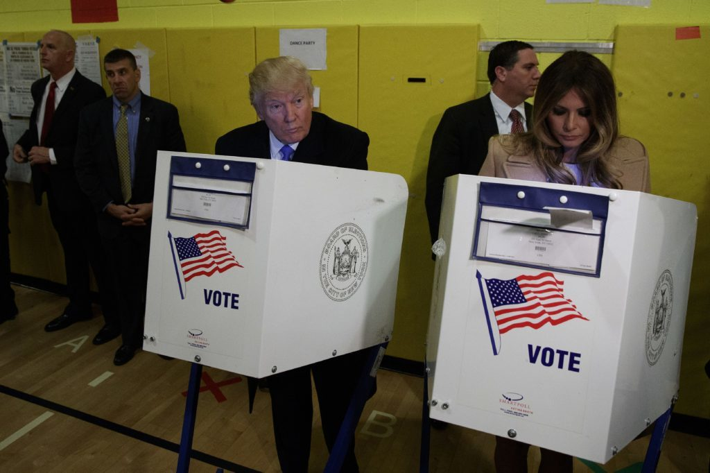 Republican presidential candidate Donald Trump, and his wife Melania, casts their ballots at PS-59 in New York.