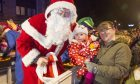Santa meeting a young visitor at the Forfar Christmas lights switch-on.