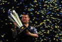 LONDON, ENGLAND - JANUARY 03:  Gary Anderson of Scotland celebrates with the Sid Waddell Trophy after defeating Adrian Lewis of England in the final match during Day Fifteen of the 2016 William Hill PDC World Darts Championships at Alexandra Palace on January 3, 2016 in London, England.  (Photo by Dan Mullan/Getty Images)