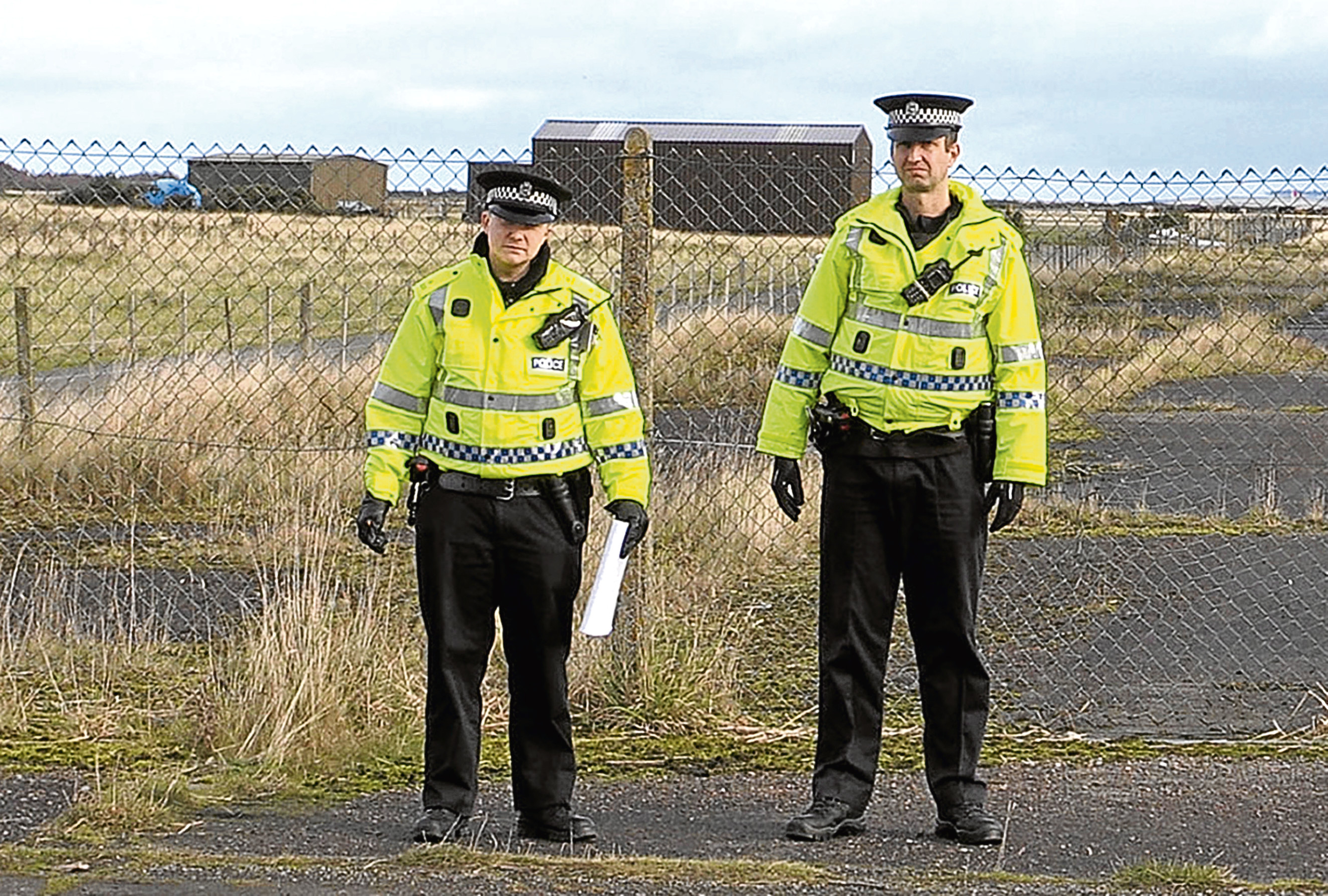 Police outside RAF Tain.